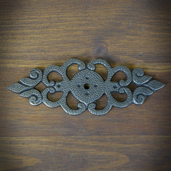 Rosette decorated under furniture knob