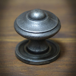 Furniture knob with a rosette