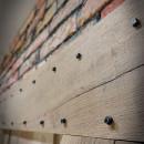 raw oak door with nails